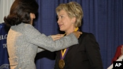 Senator Hillary Rodham Clinton receives her medal after being named to the National Women's Hall of Fame in Seneca Falls, N.Y.