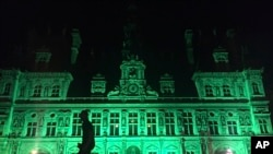 The City Hall of Paris, France is illuminated in green, June 1, 2017, following the announcement by US President Donald Trump that the United States will withdraw from the 2015 Paris accord and try to negotiate a new global deal on climate change.