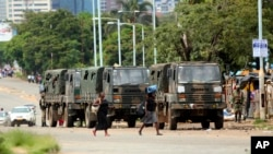 FILE - Zimbabwe soldiers are placed where police are clashing with protesters over fuel hikes in Harare, Jan. 14, 2019.