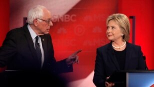 Democratic U.S. presidential candidate Senator Bernie Sanders (L) speaks directly to former Secretary of State Hillary Clinton as they discuss issues during the Democratic presidential candidates debate sponsored by MSNBC at the University of New Hampshir