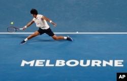 South Korea's Chung Hyeon makes a backhand return to Serbia's Novak Djokovic