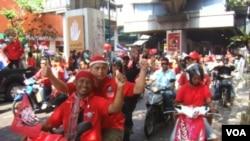 Demonstran kaos merah meneruskan unjuk rasa anti-pemerintah di Bangkok, 20 Maret 2010.