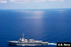 FILE - USS Lassen (DDG 82) operates in international waters near the Chinese People's Liberation Army (Navy) Jianghu V-class frigate Dongguan (560) while on patrol in U.S. 7th Fleet at South China Sea, Sep 29, 2015.