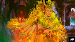 Performers rehearse ahead of the First World Conference on Tourism for Development in Beijing, China, May 17, 2016. (AP Photo/Ng Han Guan)