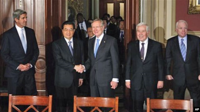 Senate Majority Leader Harry Reid greets China's President Hu Jintao on Capitol Hill in Washington, 20 Jan 2011