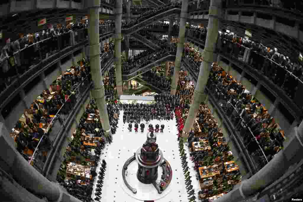 Lloyd's of London staff hold their annual Remembrance Day service at the Lloyd's building in the City of London, Britain.