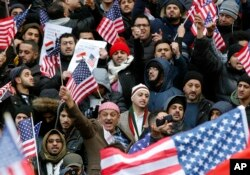 Muslims and Yemenis gather with their supporters on the steps of Brooklyn's Borough Hall, during a protest against President Donald Trump's temporary travel ban on citizens from seven predominantly Muslim countries, Thursday, Feb. 2, 2017