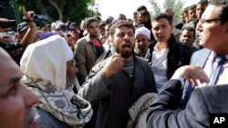 Des chrétien coptes dont les proches ont été enlevés en Libye au CAire, Egypte, le 19 janvier 2015.