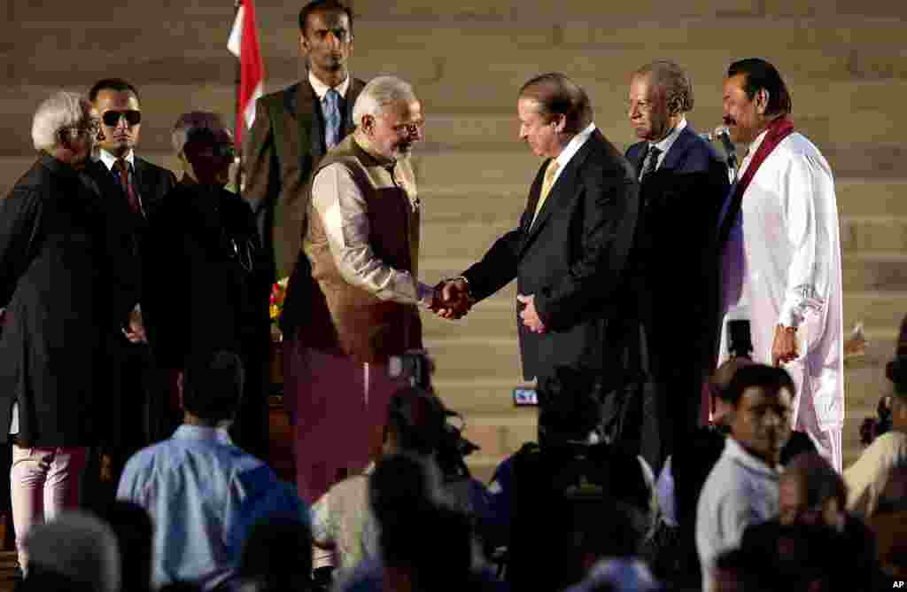 Indian Prime Minister Narendra Modi shakes hands with his Pakistani counterpart Nawaz Sharif, as Sri Lankan President Mahinda Rajapaksa and Mauritius Prime Minister Navinchandra Ramgoolam watch during Mr. Modi's inauguration in New Delhi, May 26, 2014.