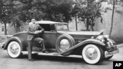 Actor Clark Gable poses in this 1932 photo with his Packard automobile. (AP Photo)