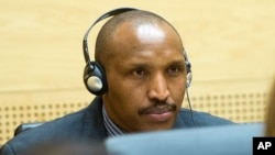 FILE - Bosco Ntaganda awaits the start of a hearing at the International Criminal Court (ICC) in The Hague, Netherlands.