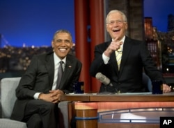 President Barack Obama with host David Letterman take a break during a taping of CBS's The Late Show with David Letterman at the Ed Sullivan Theater in New York, May 4, 2015.