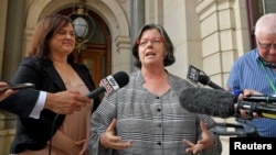 State Greens member for Western Metro Colleen Hartland and Greens member for South Eastern Metro Nina Springle give their reactions outside Parliament House during a news conference after an assisted dying vote in Melbourne, Australia, Nov. 29, 2017.