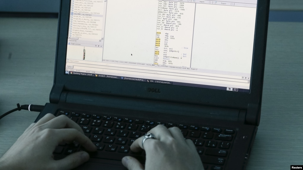 FILE - A laptop shows part of a code, which is the component of Petya malware computer virus, according to representatives of Ukrainian cybersecurity firm ISSP, at the firm's office in Kyiv, Ukraine, July 4, 2017.