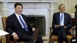 """Shugaba Barack Obama yake ganawa da mataimakin shugaban kasar China Xi Jinping a ofishin shugaban Amurka """"Oval Office"""""""