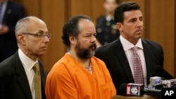 Ariel Castro, center, stands before a judge with his defense attorneys, Jaye Schlachet, left, and Craig Weintraub during Castro's arraignment on an expanded 977-count indictment, July 17, 2013, in Cleveland.