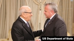 Deputy Secretary of State John Sullivan shakes hands with Tunisian President Caid Essebsi during his recent visit to the region.