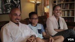 Jeremy Randall and Ariam Mohamed are experiencing their first Ramadan together as newlyweds. Jeremy's son, Jeremiah, 10, is not Muslim. He says he tries not to tempt them during their fasts. (B. Ayoub/VOA)