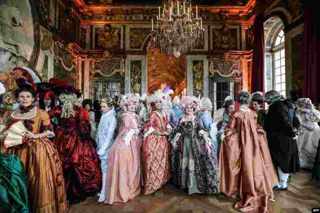 "People dressed in period costumes take part in the ""Fetes Galantes"" fancy dress evening at the ""galerie des glaces"" in the Chateau de Versailles, France, May 27, 2019."
