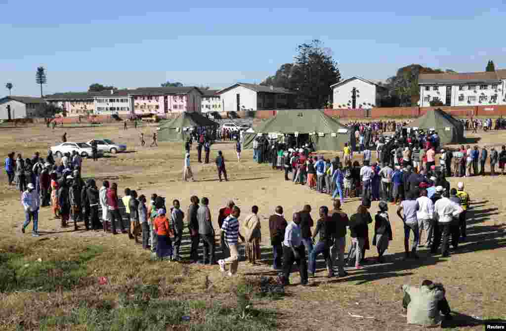 Voters line up to vote in the general elections in Harare, Zimbabwe.