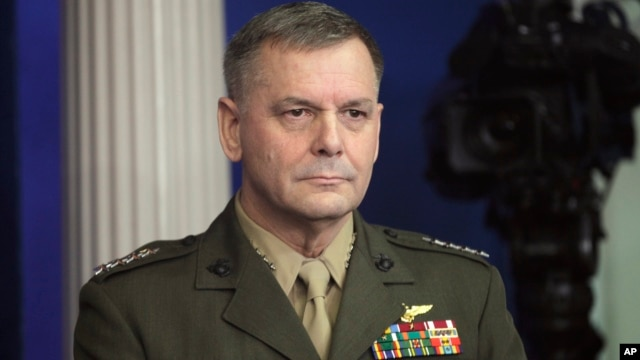 In this Dec. 16, 2010, photo, Vice Chairman of the Joint Chiefs of Staff Marine Gen. James Cartwright listens as President Barack Obama speaks about the Afghanistan-Pakistan Annual Review at the White House in Washington.