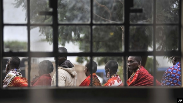 Masaai line up to vote in a general election outside an elementary school in Kumpa, Kenya, March 4, 2013.