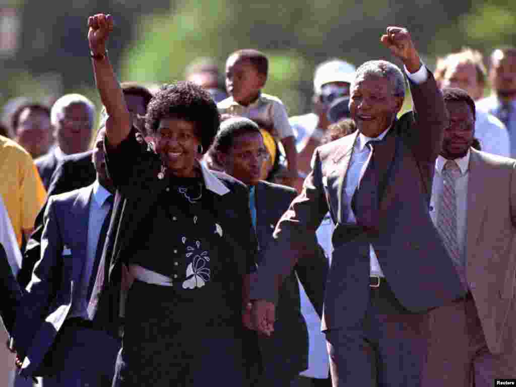 Nelson Mandela and his then wife, Winnie, salute well-wishers as he leaves Victor Verster prison on Feb. 11, 1990.