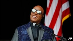 FILE - Singer Stevie Wonder, featured among artists paying tribute to Prince Thursday night, performs at the dedication ceremony for the Smithsonian Museum of African American History and Culture in Washington, Sept. 24, 2016.