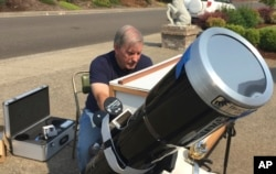 Amateur astronomer Mike Conley practices with the telescope he will use to document the Aug. 21 total solar eclipse, at his home in Salem, Ore., Aug. 3, 2017.