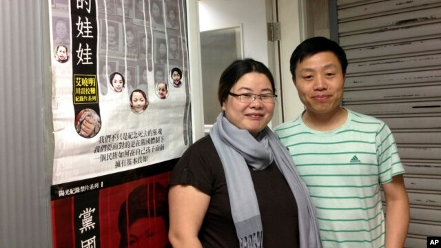 Beijing-based video and photojournalist Du Bin, right, poses for photos with Chinese activist Ye Haiyan outside the venue in Hong Kong where Du Bin first publicly screened his documentary, May 1, 2013.
