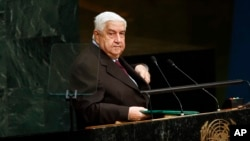 Menteri Luar Negeri Suriah Walid al-Moallem setelah berbicara di hadapan Sidang Majelis Umum PBB, Jumat pagi (2/10). (AP Photo/Jason DeCrow)