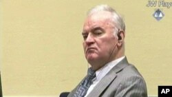 FILE - А Dec. 5, 2016, file photo taken from video shows former Bosnian Serb military commander Gen. Ratko Mladic as he looks across the court room at the International Criminal Tribunal for the Former Yugoslavia in The Hague Netherlands.