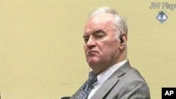 FILE - А Dec. 5, 2016, photo taken from video shows former Bosnian Serb military commander Gen. Ratko Mladic as he looks across the courtroom at the International Criminal Tribunal for the Former Yugoslavia in The Hague, Netherlands.