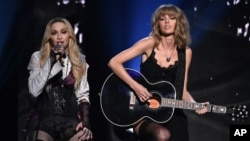 Madonna, left, and Taylor Swift perform on stage at the iHeartRadio Music Awards at The Shrine Auditorium in Los Angeles, March 29, 2015.