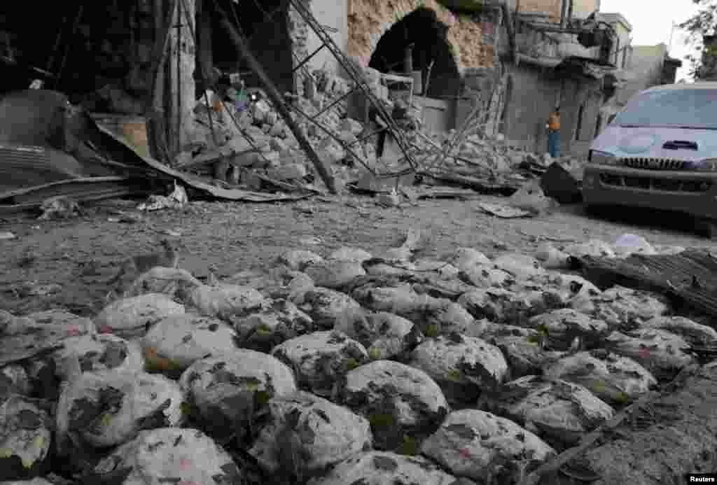 Stacks of bread are seen at a damaged site after an airstrike in the rebel-held Bab al-Maqam neighborhood of Aleppo, Syria, September 28, 2016.