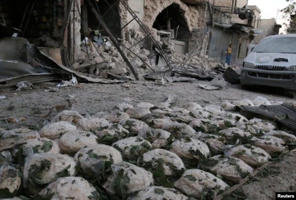Stacks of bread are seen at a damaged site after an airstrike in the rebel-held Bab al-Maqam neighbourhood of Aleppo, Syria, Sept. 28, 2016.