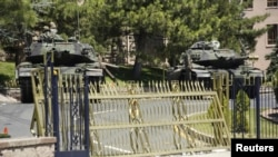 Tanks stand in front of the Turkish General Staff headquarters in Ankara, Turkey, July 17, 2016.
