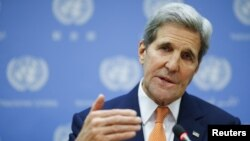 FILE - U.S. Secretary of State John Kerry speaks to the media during a news conference at the United Nations Headquarters in Manhattan, New York, Dec. 18, 2015.
