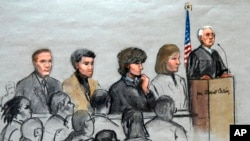 In this courtroom sketch, Boston Marathon bombing suspect Dzhokhar Tsarnaev, third from right, is depicted with his lawyers and U.S. District Judge George O'Toole at the federal courthouse in Boston Jan. 6, 2015.