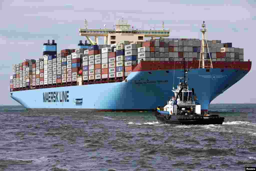 The MV Maersk Mc-Kinney Moller, the world's biggest container ship, arrives at the harbor of Rotterdam, the Netherlands. The 55,000-ton ship, named after the son of the founder of the oil and shipping group A.P. Moller-Maersk, has a length of 400 meters and cost $185 million.