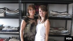 Charlotte Ferguson (left) is working for her daughter Alexandra's home decorating business. (VOA/A. Milne-Tyte)