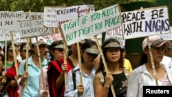 FILE - Activists of the National Socialist Council of Nagaland (NSCN) hold placards and shout slogans during a demonstration in New Delhi.
