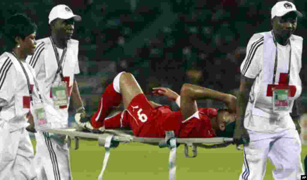 """Rodolfo Bodipo, captain of the Equatorial Guinea team, is carried on a stretcher after he was injured during the opening match against Libya in the African Nations Cup soccer tournament in Estadio de Bata """"Bata Stadium"""", in Bata January 21, 2012."""
