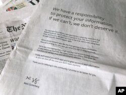 An advertisement in The New York Times is displayed on March 25, 2018, in New York. Facebook's CEO has apologized for the Cambridge Analytica scandal with ads in multiple U.S. and British newspapers.