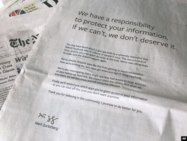 FILE - An advertisement in The New York Times is displayed, March 25, 2018, in New York. Facebook's CEO apologized for the Cambridge Analytica scandal with ads in multiple U.S. and British newspapers.