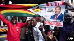 FILE: Supporters of MDC (Movement for Democratic Change Alliance) leader and opposition presidential candidate cheer outside the MDC headquarters in Harare, on July 31, 2018.