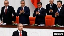 Turkey's President Recep Tayyip Erdogan, lower left, attends a debate marking the reconvening of parliament after a summer recess at the Turkish Parliament in Ankara, Oct. 1, 2014.