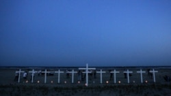 Eleven crosses represent the workers who died in the Deepwater Horizon oil rig explosion