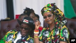 FILE - Grace Mugabe is seen with her husband, then-President Robert Mugabe, at a rally in Gweru, Zimbabwe, Sept, 1, 2017.