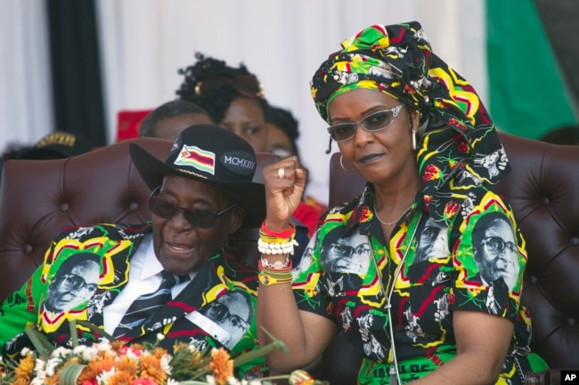 FILE - Zimbabwean first lady Grace Mugabe, right, is seen during better times with her husband, President Robert Mugabe, at a rally in Gweru, Zimbabwe, Sept, 1, 2017.